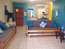 Modern, spacious 2 bedrooms, 2 bathroom ground floor unit close to all amenities, approximately 200 meters to main beach. Open plan lounge, dining room and kitchen (fully equipped with washing machine & tumble drier). 1st bathroom (tub), en-suite bathroom (shower). Patio, communal braai and pool area available. Under cover parking + visitors parking available with 24 hour security surveillance. (Sleeps 6).