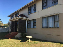 Ideal for either extended families, or income generator. Close to shops and the ocean. 4 x units, 2 upstairs and 2 downstairs all consisting of 2 bedrooms, 1 bathroom, kitchen, open plan lounge dining area with enclosed balcony with sea views. lovely spacious garden well maintained, 4 single lock up garages. Priced right at R2 400,000.00